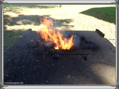 Coal burning bright in fire pot for blacksmithing