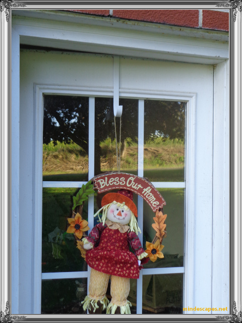 Over the door decoration holder holding scarecrow fall wreath