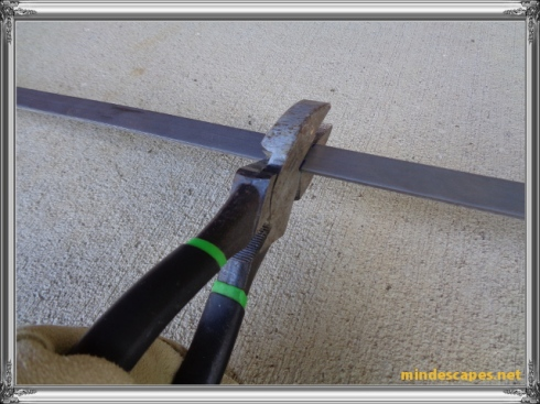 straight cutter on square nosed pliers making an indentation on steel strip