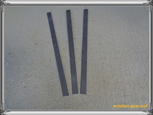 three strips of steel 16 inches long