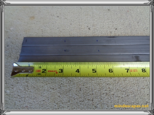 tape measure showing markings on the 3 steel strips at 3 inches and 5 and 1/4 inches